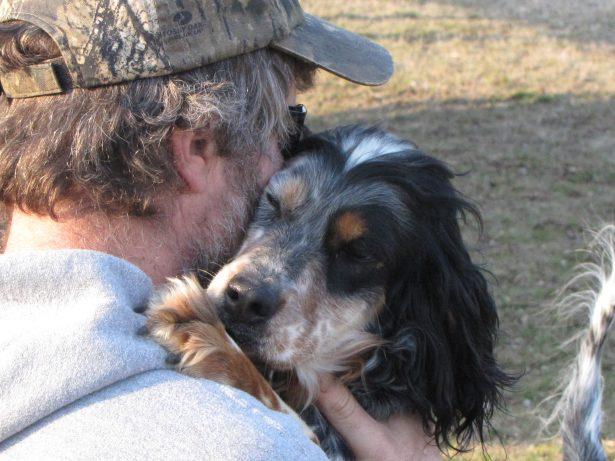 Bird dog, Llewellyn Setter, Laurel Mt. Majesty giving Scott a hug.